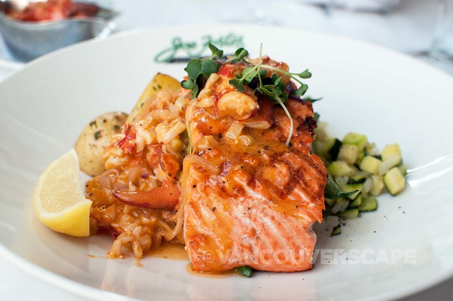 Coho salmon topped with chopped lobster and smoked heirloom tomatoes, greens, lemon beurre blanc