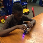 Kijuan working on one of the r/c helicopters
