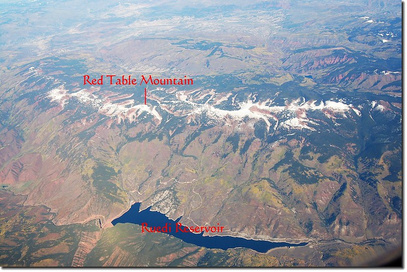 Looking down Ruedi Reservoir from the air,the mountain that snow covered is Red Table Mt. 2