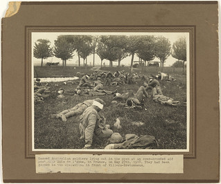 Gassed Australian soldiers lying out in the open at an over-crowded aid post near Bois de l'Abbe ... They had been gassed in the operations in front of Villers-Bretonneux