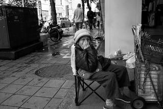 elderly sidewalk vendor