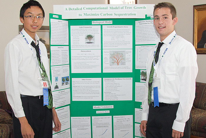 Albert Zuo, left, and Eli Echt-Wilson of Albuquerque La Cueva High School with their poster. They won the top award at the 24th New Mexico Supercomputing Challenge at Los Alamos National Laboratory.