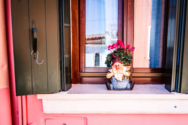 Many colorful houses in Burano have a little surprise in the windowsill, gnomes!
