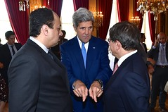 U.S. Secretary of State John Kerry chats with Qatari Foreign Minister Khalid Al Attiyah and Turkish Foreign Minister Ahmet Davutoglu at the Quai d'Orsay in Paris, France, on July 26, 2014, after a group meeting about a cease-fire in the fighting between Israel and Hamas in the Gaza Strip. [State Department photo/ Public Domain]
