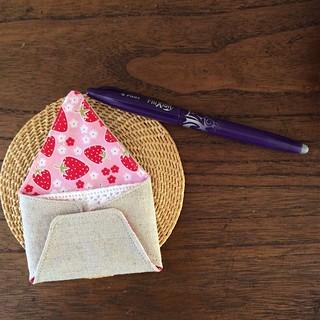 Back side of envelope needle book