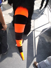 high-heeled footwear(0.0), red(0.0), leggings(0.0), thigh(0.0), tights(0.0), orange(1.0), pattern(1.0), textile(1.0), footwear(1.0), clothing(1.0), yellow(1.0), trousers(1.0), shoe(1.0), limb(1.0), leg(1.0),