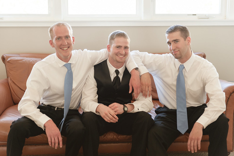 A groom and his brothers laugh as they wait for the wedding to start in Maui, Hawaii