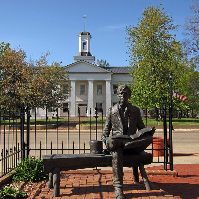 Young Lincoln before the Illinois statehouse at Vandalia