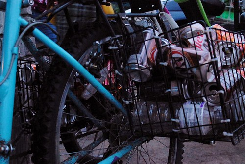 bike with baskets loaded with pop cans to return for recycle