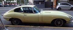 "Jaguar ""E"" Type, pale yellow, 4.2 liter straight 6, starboard profile"
