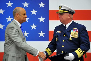 Vice Adm. John Currier is thanked by Department of Homeland Security Secretary Jeh Johnson during the vice commandant change of watch ceremony at Coast Guard Headquarters in Washington, D.C., Tuesday, May 20, 2014.  Currier was the 28th vice commandant of the Coast Guard.  U.S. Coast Guard photo Petty Officer 2nd Class Patrick Kelley.