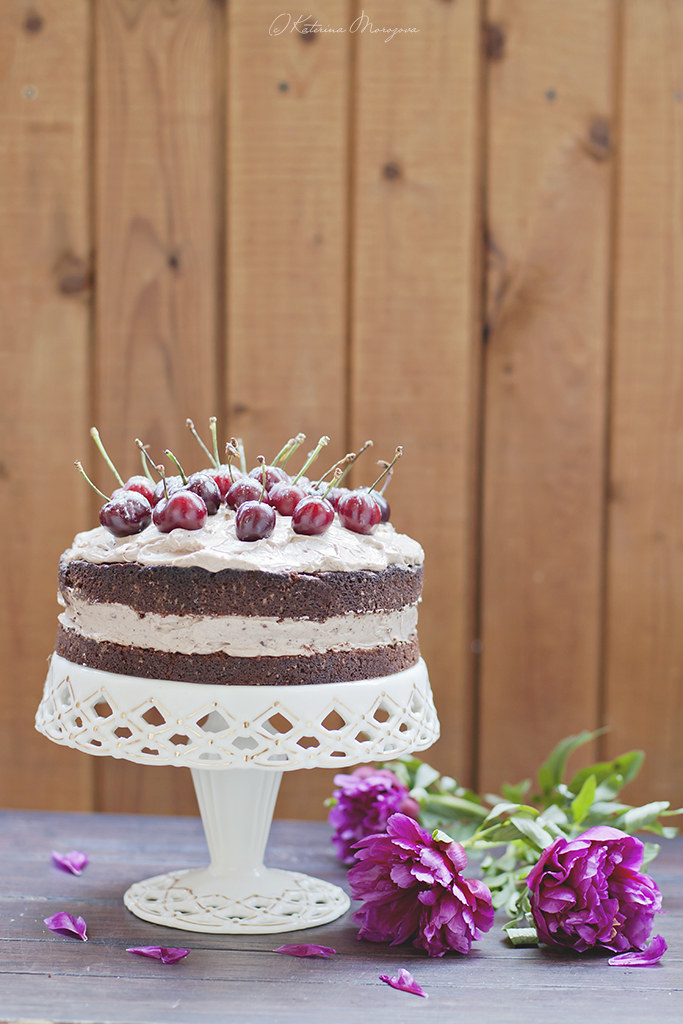 Chocolate mascarpone cake with cherry.