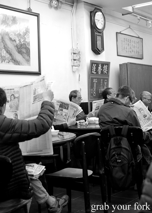 The usual crowd at Lin Heung Tea House in Hong Kong - men with newspapers