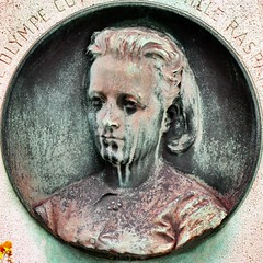 Young woman on verdigris medallion