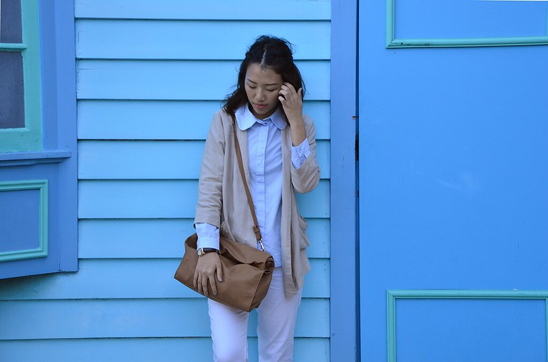 blue blouse, neutral cardigan, fold over leather clutch
