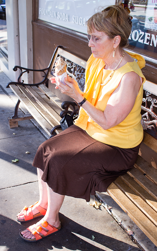 eating ice cream, banana yellow blouse, brown skirt, and orange sandals