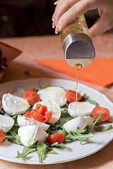 Preparing caprese salad