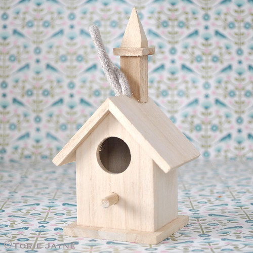 Wooden bird house with steeple