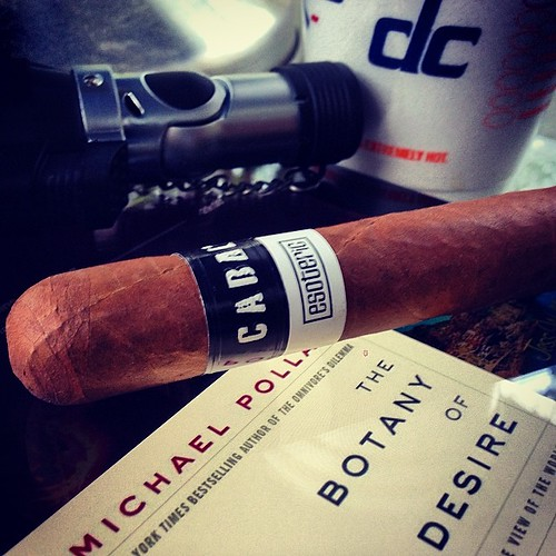 Quiet night in the studios with a @cabalcigars esoteric, dunkin coffee a #michaelpollan book.