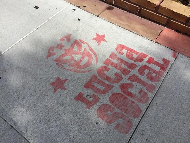Lucha Social sidewalk stencil