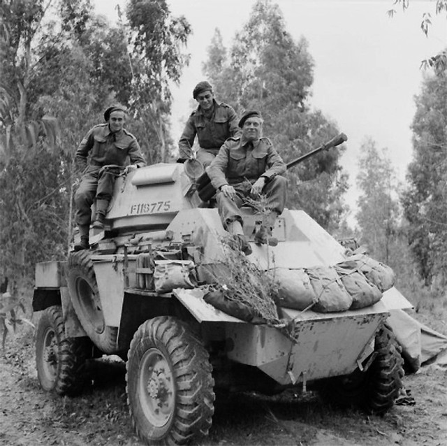 A Humber Mk II armoured car and crew of 'B' Squadron, 11th Hussars