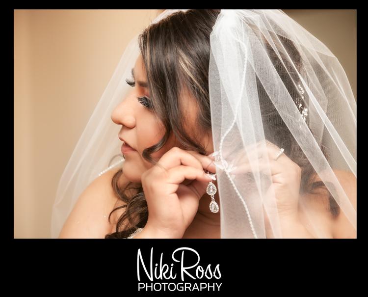 BridePutEaringsOn