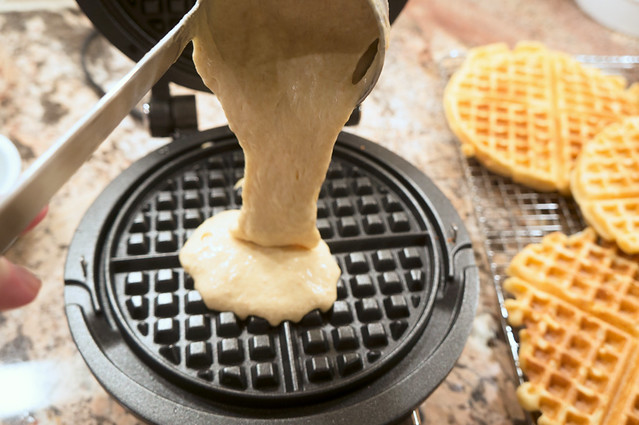 pouring waffle batter