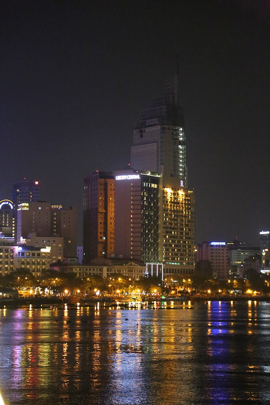 Buildings at night by the Saigon river