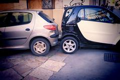automobile(1.0), automotive exterior(1.0), peugeot(1.0), wheel(1.0), vehicle(1.0), peugeot 206(1.0), city car(1.0), bumper(1.0), land vehicle(1.0), hatchback(1.0),
