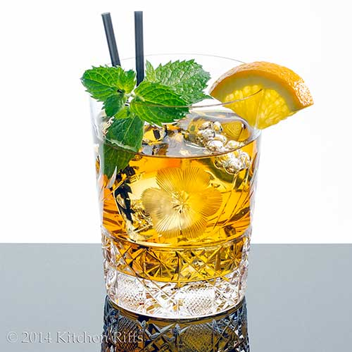 Brandy Smash Cocktail with orange and mint garnish