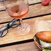 Lunchtime meal: a rosé, a burger and eyeglasses removed. #rose #hamburger #lunch #gottsroadside (July 18, 2014, San Francisco, CA)