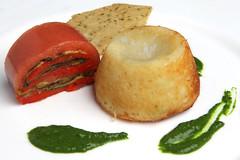 Tortino fondente di pecorino, millefoglie di melanzane, peperoni, pomodoro, coriandolo, salsa al pesto di basilico