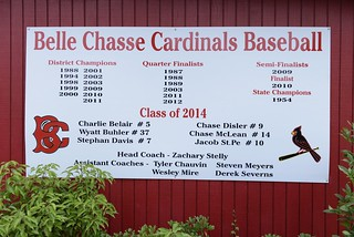 Pictured here is a board displaying the 2014 Belle Chase Cardinals Baseball Team Roster April 25, 2014. Severns is a volunteer coach for the Belle Chase Cardinals Baseball at Belle Chase High School. (U.S. Coast Guard photo by Petty Officer 3rd Class Carlos Vega)
