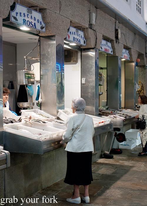 Seafood stalls at Mercado de Abastos farmers market in Santiago de Compostela, Spain