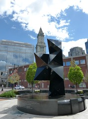 Abstract sculpture with Custom House in distance