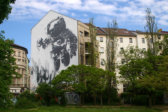Victor Ash paints astronaut/cosmonaut on building in Kreuzberg