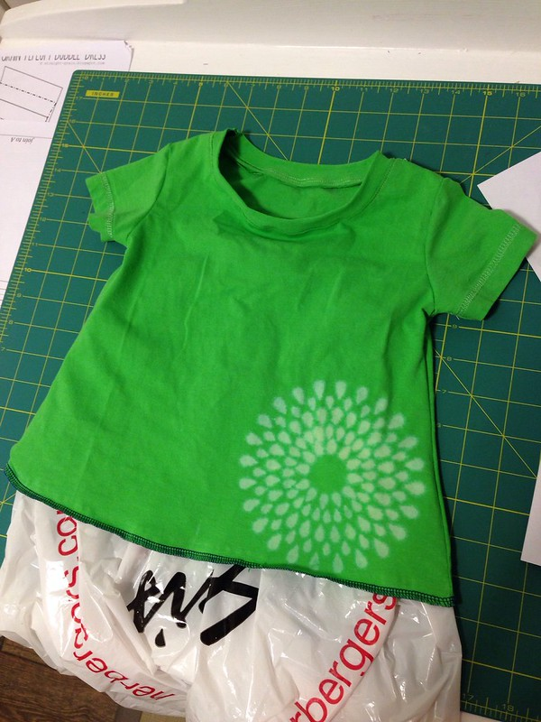 First attempt at the Nessie top. I used an old t-shirt so I don't waste good fabric. I cut the sleeves from the existing sleeves to get that edge. I also used a stencil and sprayed bleach water to make that design. Bottom will stay serged-nice contrast.