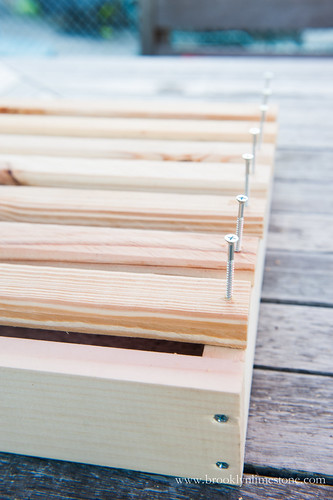 Wood Rack with slats and screws to show where to screw bottom slats into the frame