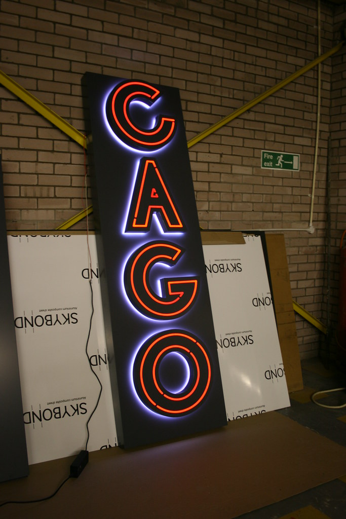 Faux neon sign using CNC routed acrylic pushed through a fret cut face, with LED illumination