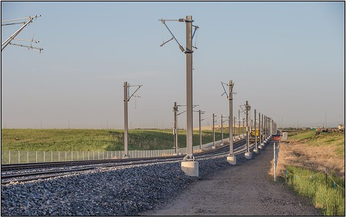 Photo of Installed rail along Peña Boulevard, June 17, 2014