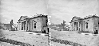 """One-storey building, possibly a railway station, with steps, and 4 column, Ionic portico"" is Armagh Courthouse"