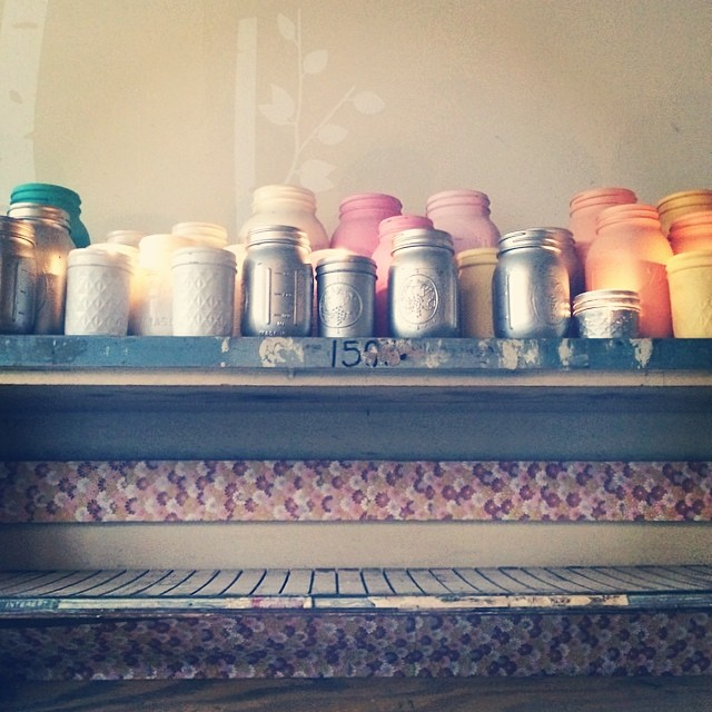 A shelf of painted jars. I'm normally opposed to painted jars, but these are kind of cool.