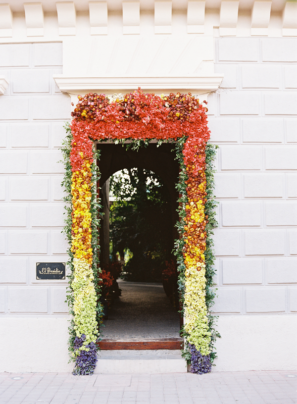 mexico-rehearsal-dinner-rainbow-flower-arch