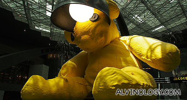 It's a giant yellow teddy bear with a lamp shade!
