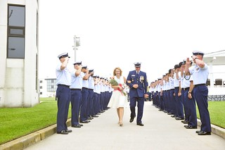 Master Chief Petty Officer Michael P. Leavitt (ret.) and his wife, Debra, depart a change-of-watch ceremony Thursday, May 22, 2014 at Coast Guard Training Center Cape May, N.J. After the change-of watch ceremony, in which Leavitt transferred his duties as MCPOCG to Master Chief Petty Officer Steven W. Cantrell, Leavitt retired following 32 years of Coast Guard service. U.S Coast Guard photo by Petty Officer 3rd Class Cynthia Oldham