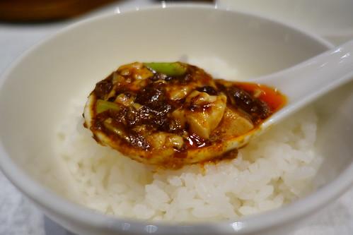 A spoonful of Shisen Hanten's Mapo Doufu on Hokkaido Rice
