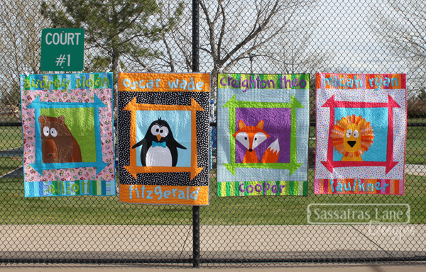 Zoey's Zoo hanging on a tennis court fence!
