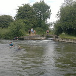 adults and children swimming and jumping in from bridge at Compton Lock#2