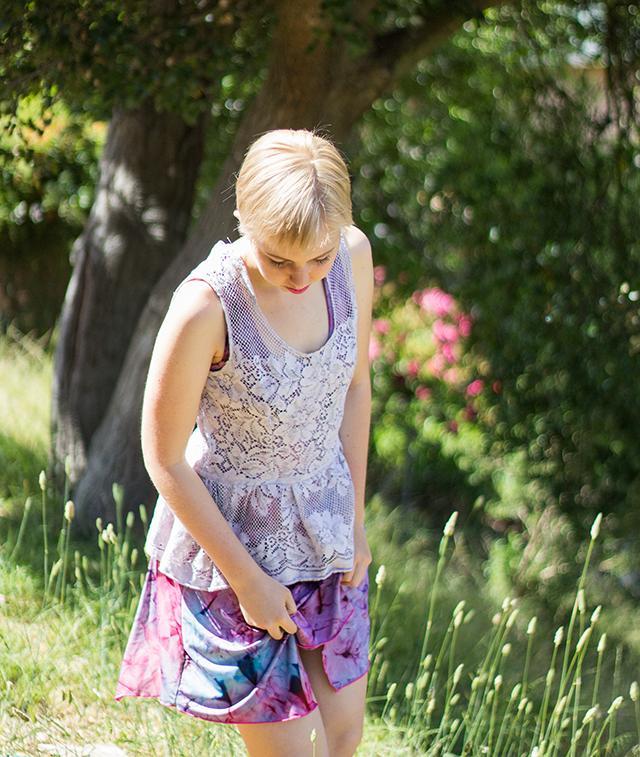 blonde pixie cut, lavender lace sleeveless peplum top, faux tie-dye purple dress