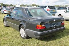 mercedes-benz w126(0.0), mercedes-benz w201(0.0), mercedes-benz e-class(0.0), automobile(1.0), automotive exterior(1.0), executive car(1.0), vehicle(1.0), mercedes-benz w124(1.0), mercedes-benz(1.0), mercedes-benz 500e(1.0), sedan(1.0), classic car(1.0), land vehicle(1.0), luxury vehicle(1.0),